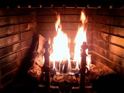 Open fireplace emitting toxic combustion by-products