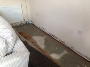Damp floor and walls after a pipe burst