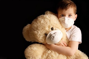 Child and teddy bear wearing pollution masks