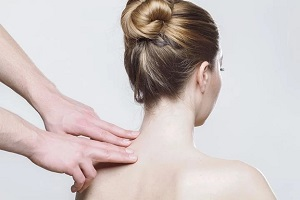 Chiropractor Working Woman's Neck