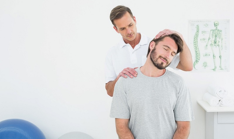 Chiropractor working the neck