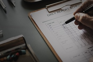 Healthcare worker writing a Daily Report Schedule