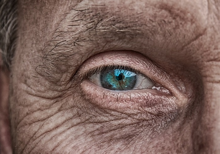 A close up view of a man's bright blue eye
