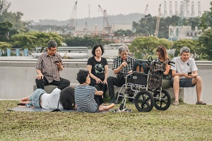 Large Family Outdoors With Wheelchair