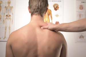 Man with back pain due to fibromyalgia