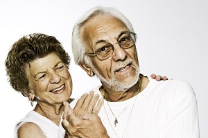 Smiling middle-aged couple with few forehead wrinkles
