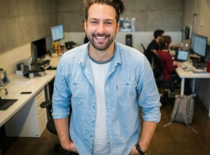Man smiling in a shared office
