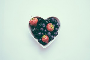 Heart-shaped bowl filled with berries