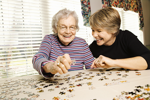 Old lady and young woman doing a jigsaw