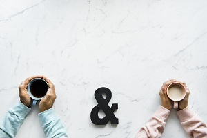 Husband and wife discuss their marriage over coffee