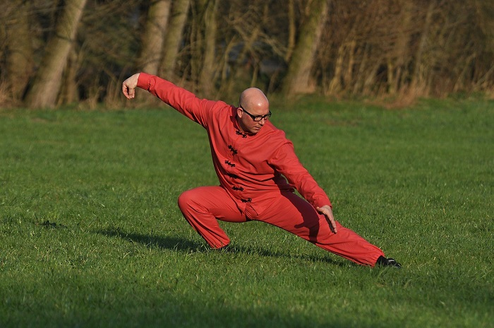 A man doing martial arts in the park