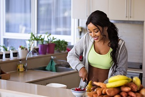 Woman preparing nutritious meal in gym gear