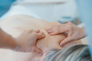 Woman having massage for a cracked neck