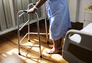 Old woman with walker in a nursing home