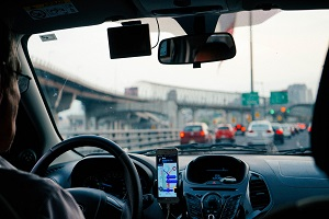 Driver using GPS navigation app on their smartphone