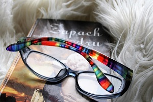 Colorful reading glasses atop a book