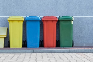 Four assorted color recycling bins