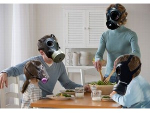 Family wearing masks to protect from toxic chemical and biological hazards