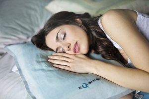 Woman sleeping well using LifeWave Silent Nights Patches