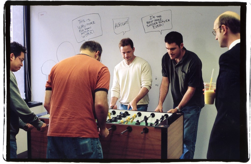 Group of men playing table football