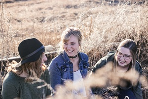 Group of young women talking and laughing