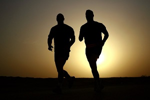 Two men out running at sunset