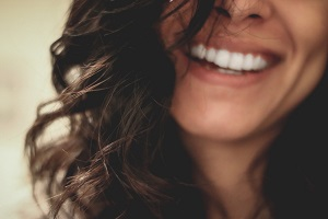 Woman with sparkling white teeth smiling